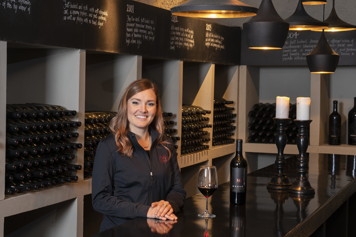 Merus Winemaker Alicia Sylvester, enjoying wine in the Merus winery