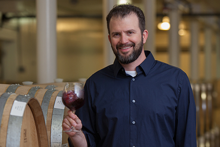 Gianni Abate sampling wine in the Chalone Vineyard barrel room.