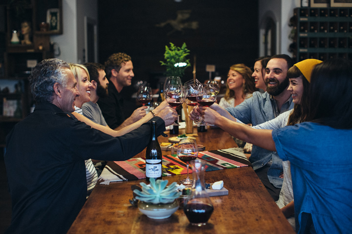 People Enjoying a Meal with Banshee Wine