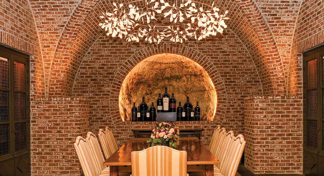 chandelier and table inside wine cave