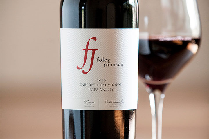 Close up of Foley Johnson wine label next to full wine glass