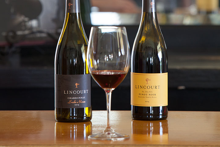Lincourt Chardonnay and Pinot Noir with filled glass in center